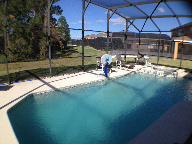 Over sized pool deck with lanai