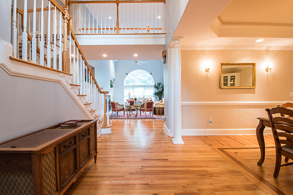 Foyer leads to an open living room and formal dining room