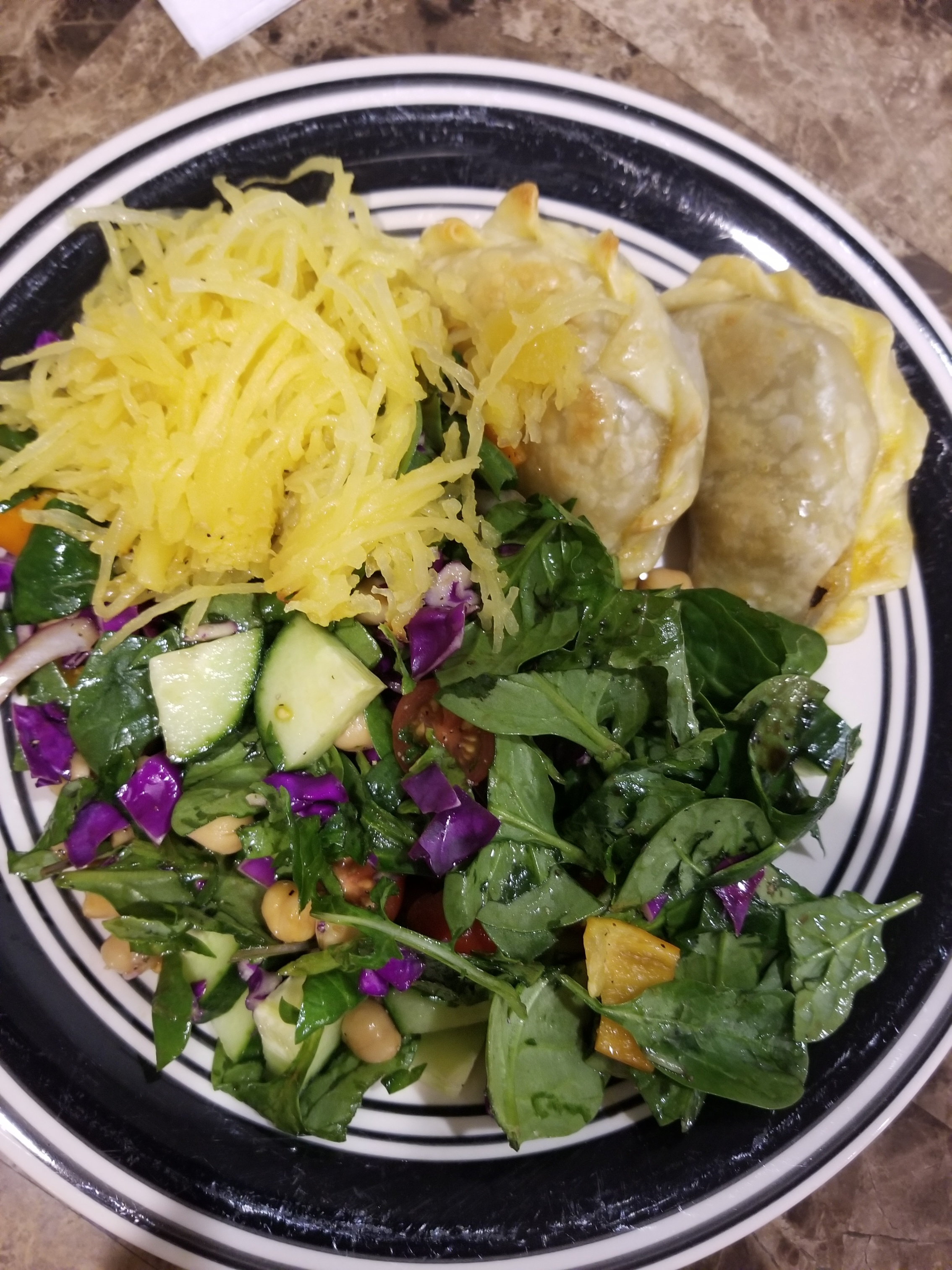 Vegetarian empanadas Argentinian style, spaghetti squash and salad