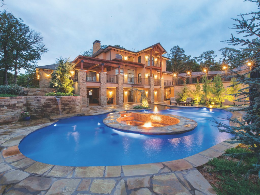 Luxury pool flagstone deck sunken fire pit and bar