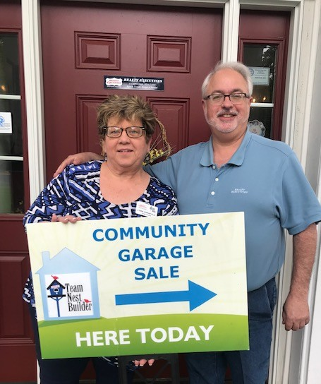 Lynn and Glenn Garafola get ready for the Team Nest Builder Sparta Mountain Community Garage Sale.
