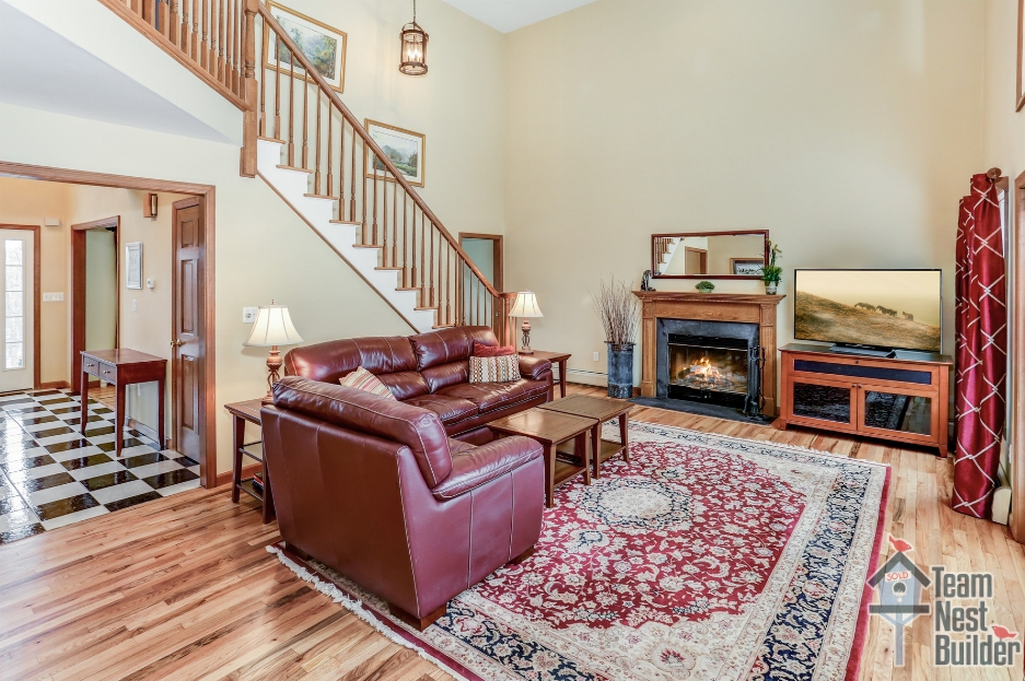 Airy, 2-story great room with fireplace.