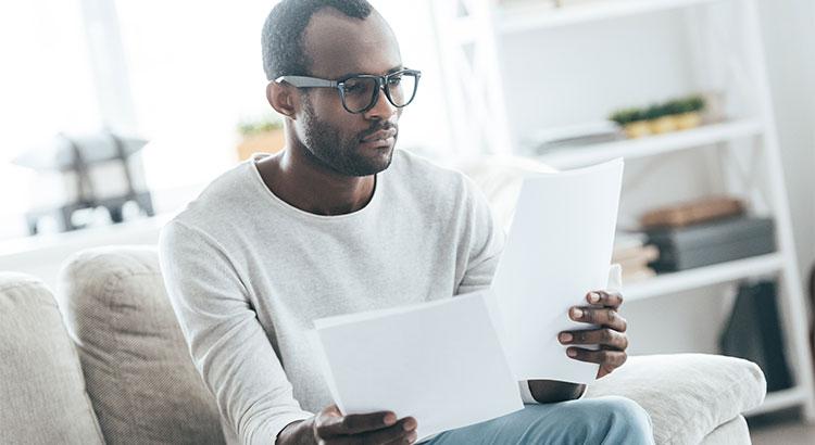 Man reading mortgage application