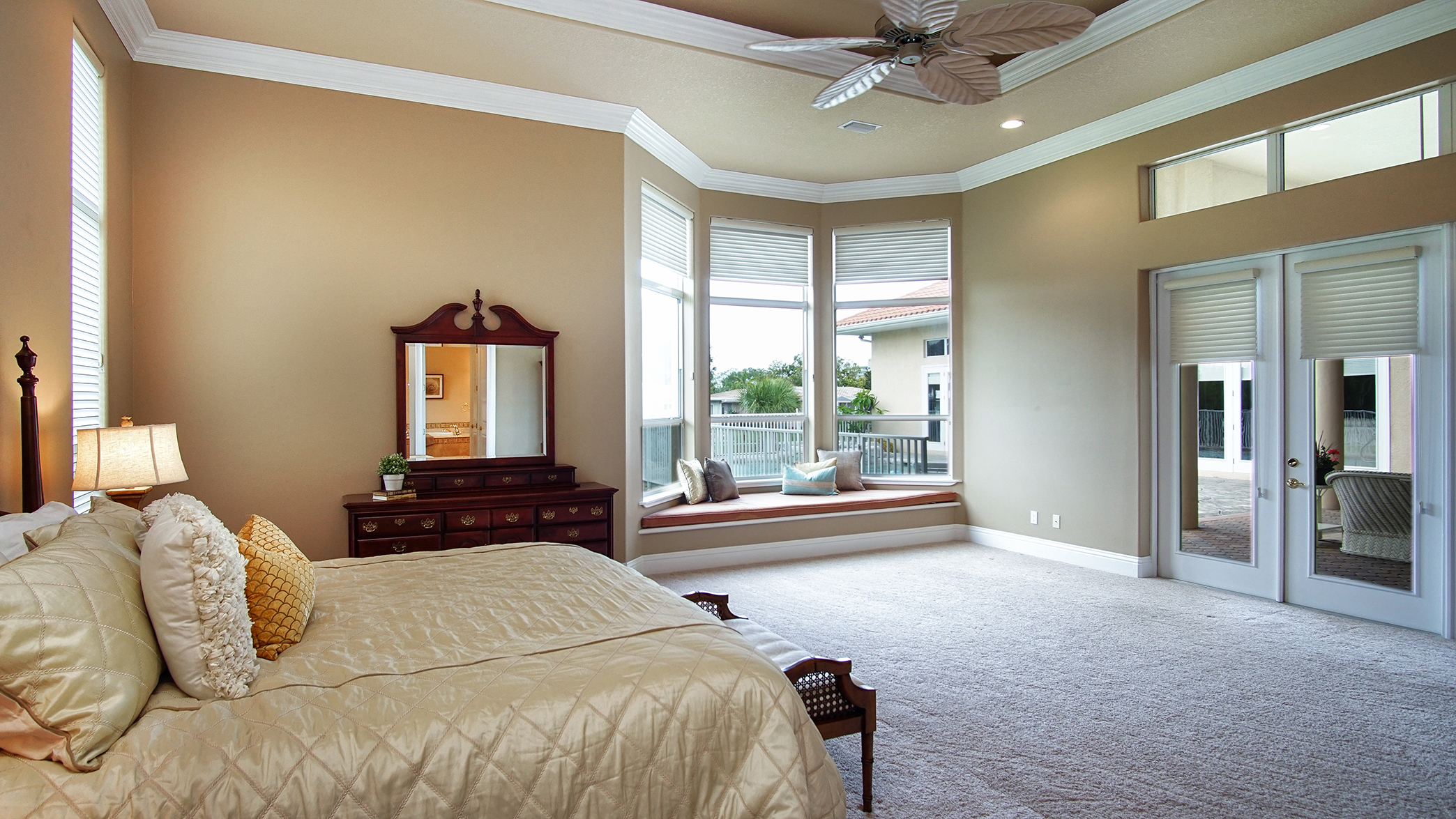 Expansive Master Suite Overlooking the Canal and Pool