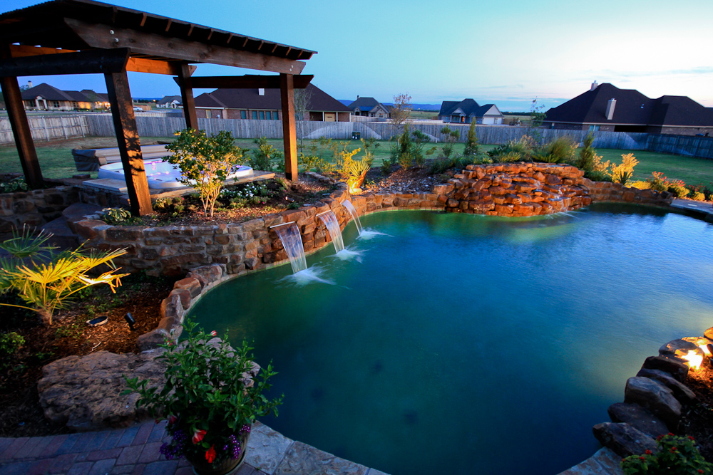 Natural stone pool with boulders and water features