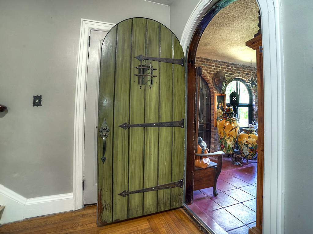 Wooden Plank Door with Wrought Iron Strap Hinges and Speak Easy Grill