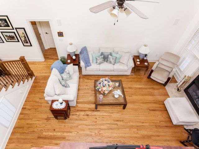Looking down into family room from loft. You can   really appreciate this lovely room from this view. Enjoy movie nights with your surround sound. Room is already wired and waiting for your system.