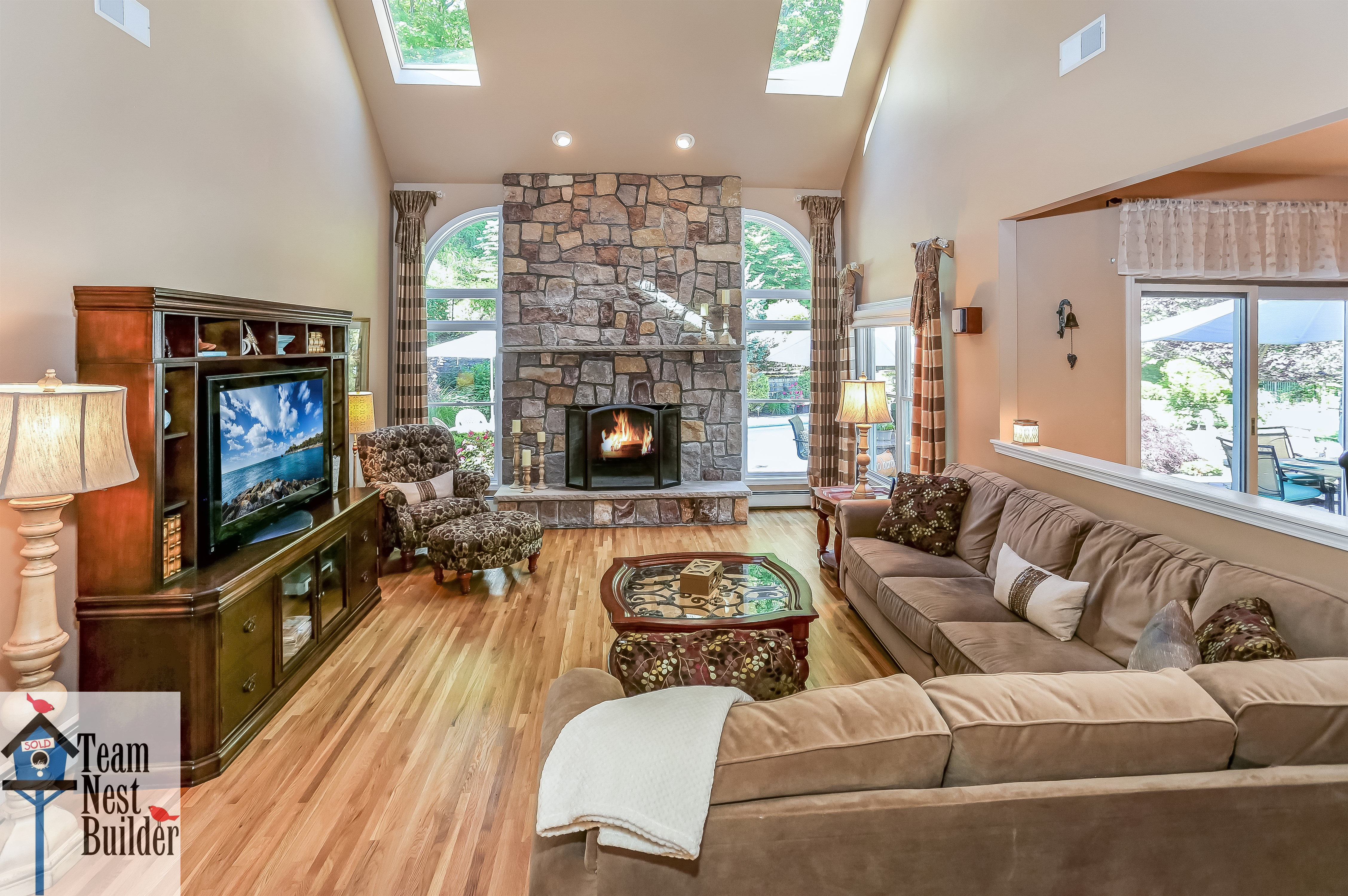 Check out the trophy floor-to-ceiling fireplace in the family room!