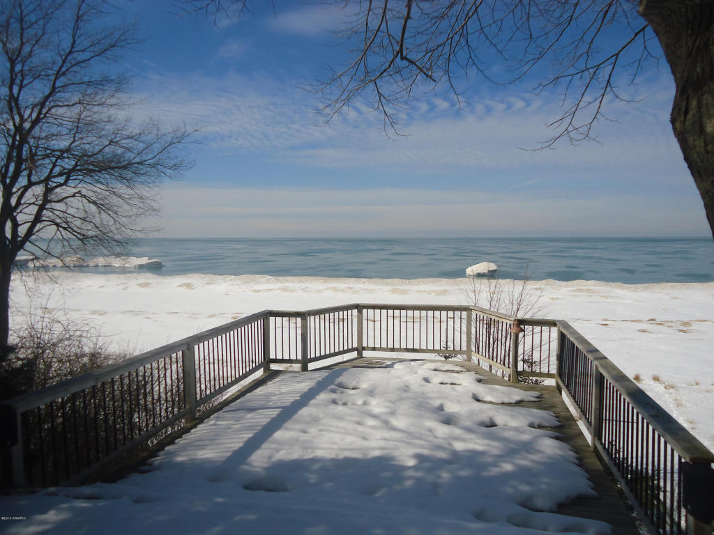 lakefront and home estate michigan in waterfront holland cottages homes luxury sale specialists cottage for original real mi