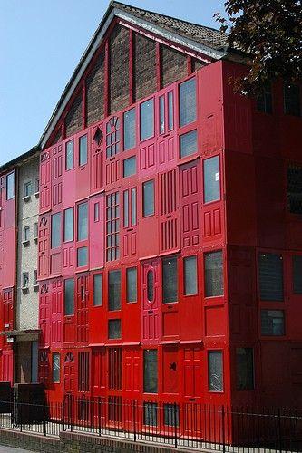 Building with red door facade
