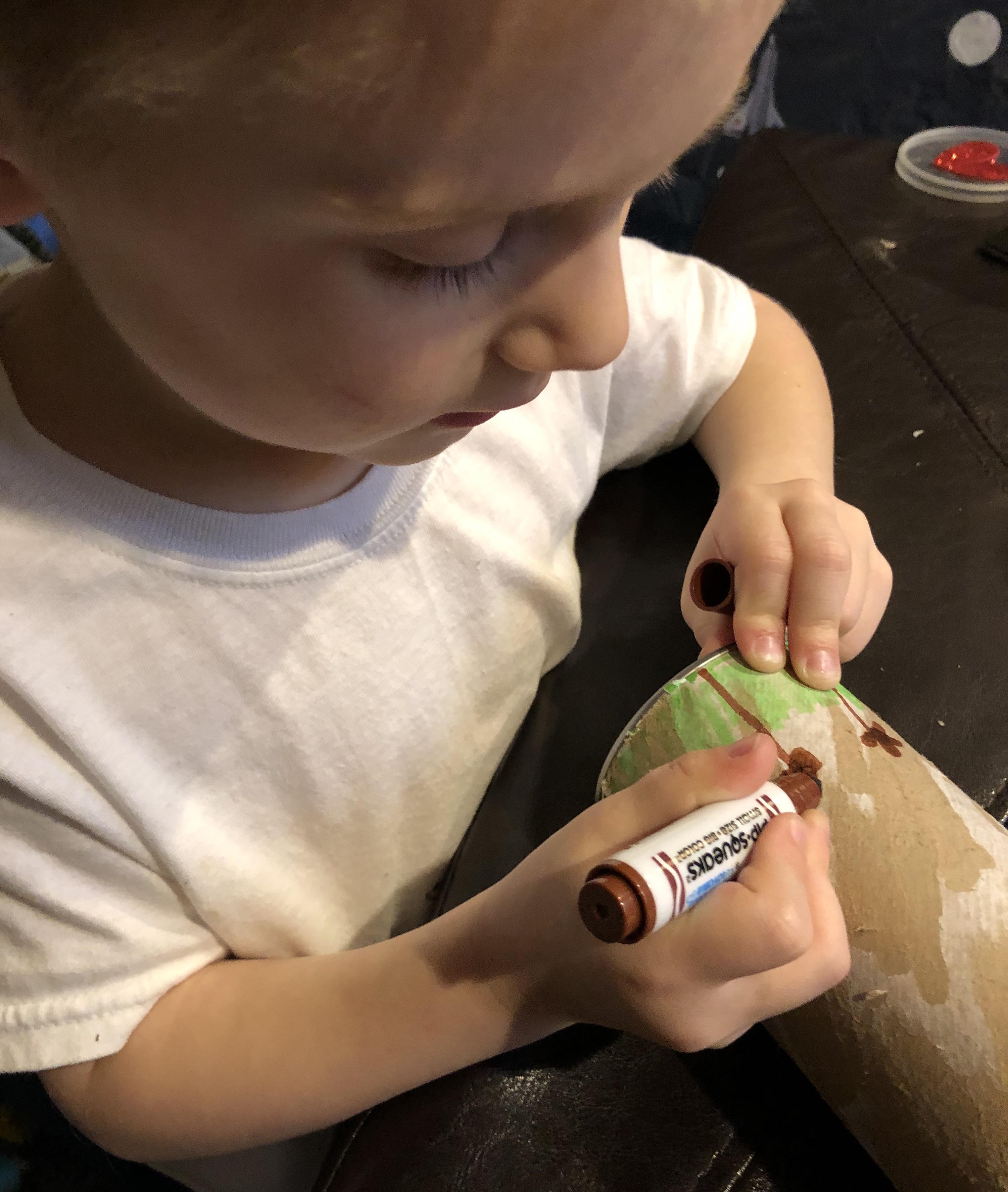 Jaxon decorates his Pringles can instrument!