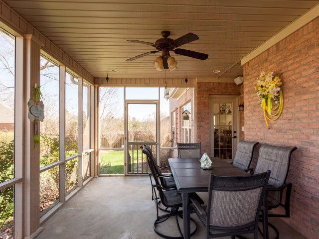 What better way to enjoy your backyard garden than sitting on this porch. You can feel the breeze without the bugs. Great place to have meal or entertain Music from surround sound adds to the enjoyment of this space.