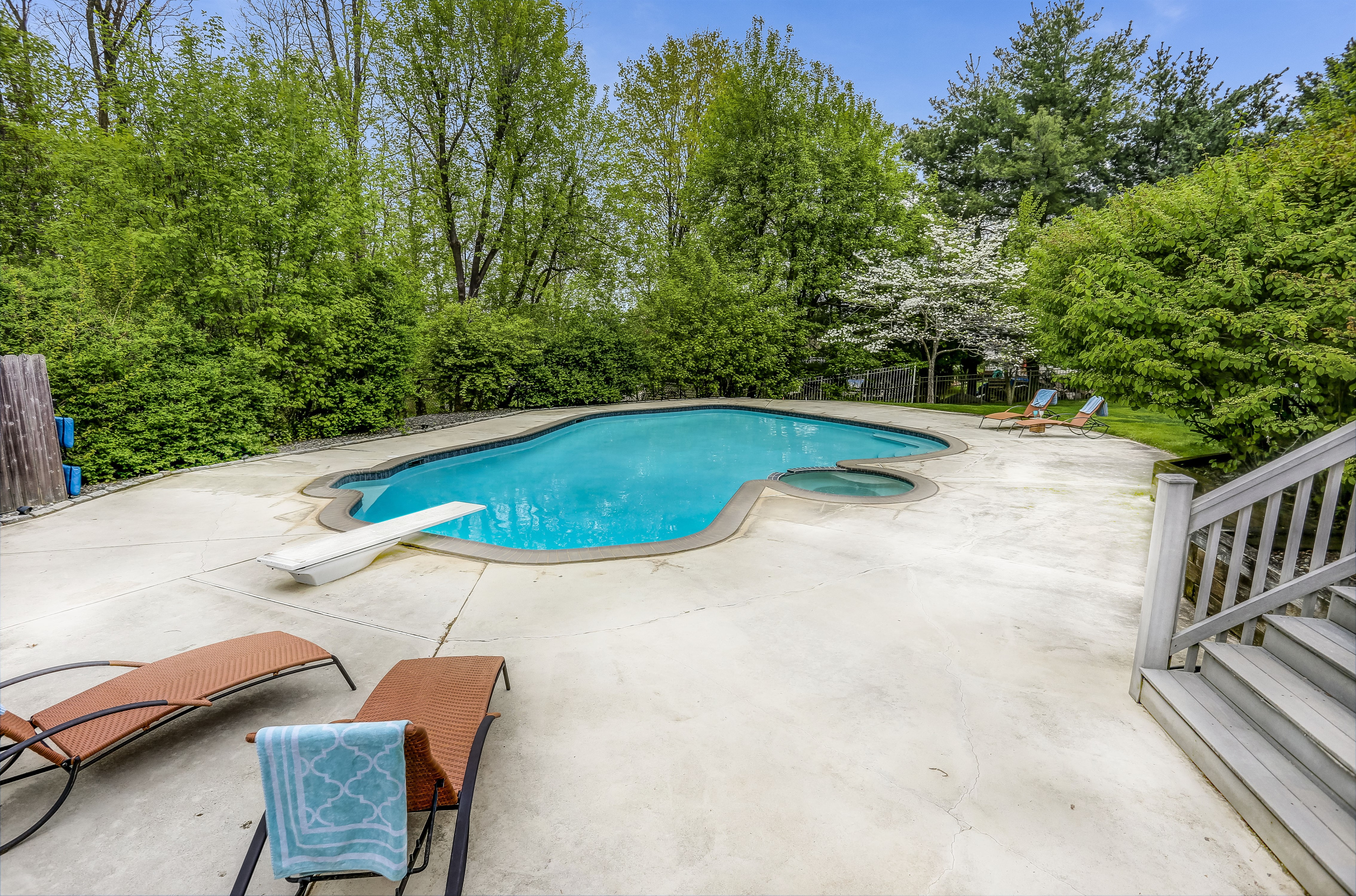 Backyard oasis with heated pool, hot tub and huge deck for entertaining!