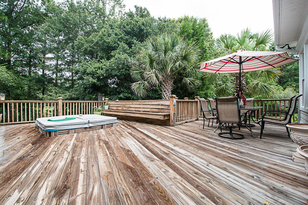 Spacious deck leads out to an expanse of back yard