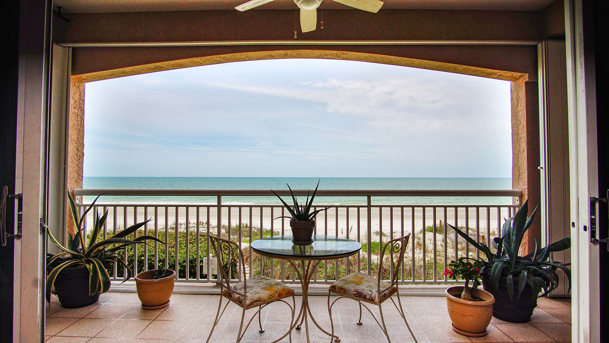 Private balcony off master suite overlooking the ocean and beach