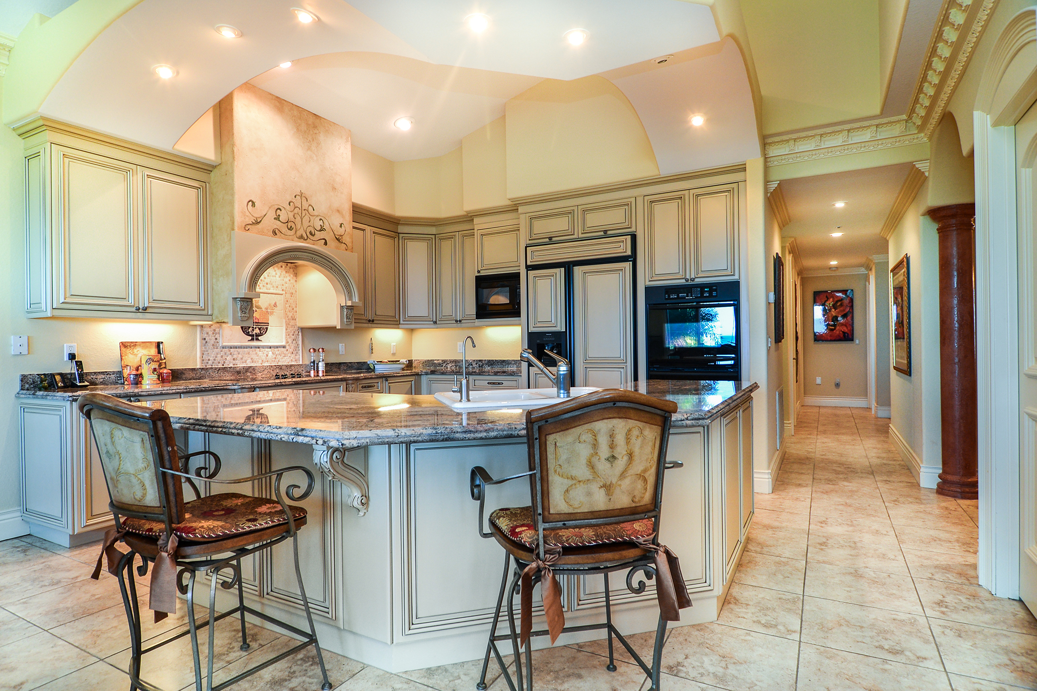 Custom Wood Cabinetry, Recessed LED Lighting and Stunning Crown Molding Throughout