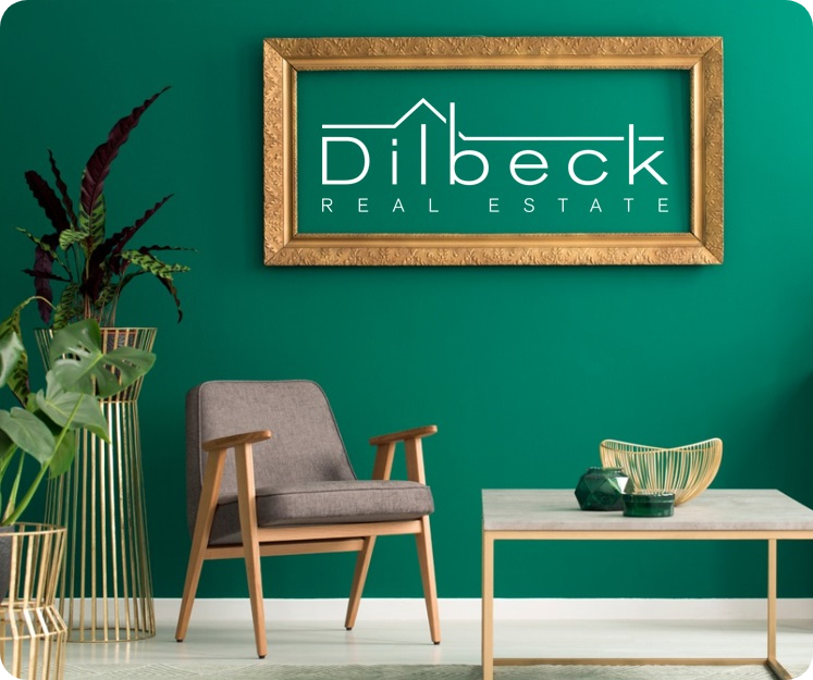room with green wall and Dilbeck Real Estate sign