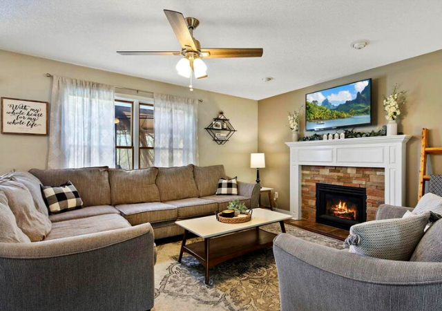front living room with overhanging lamp and gray couch