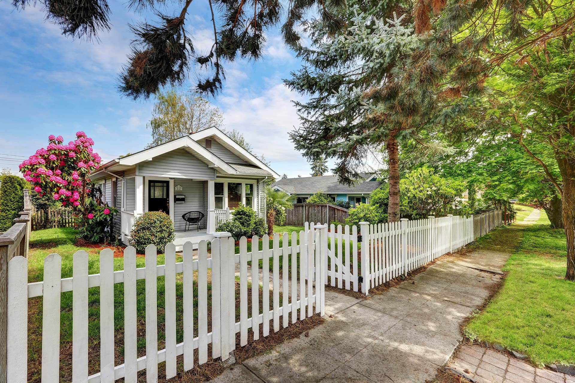 cute cottage home with picket fence