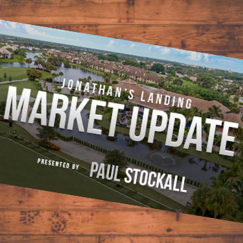 Jonathan's Landing Market Update postcard on wood background