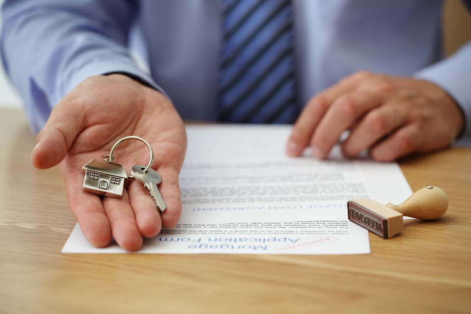 Loan officer holding house key