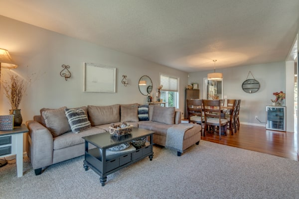 large family room beside patio with tile floors and wide table