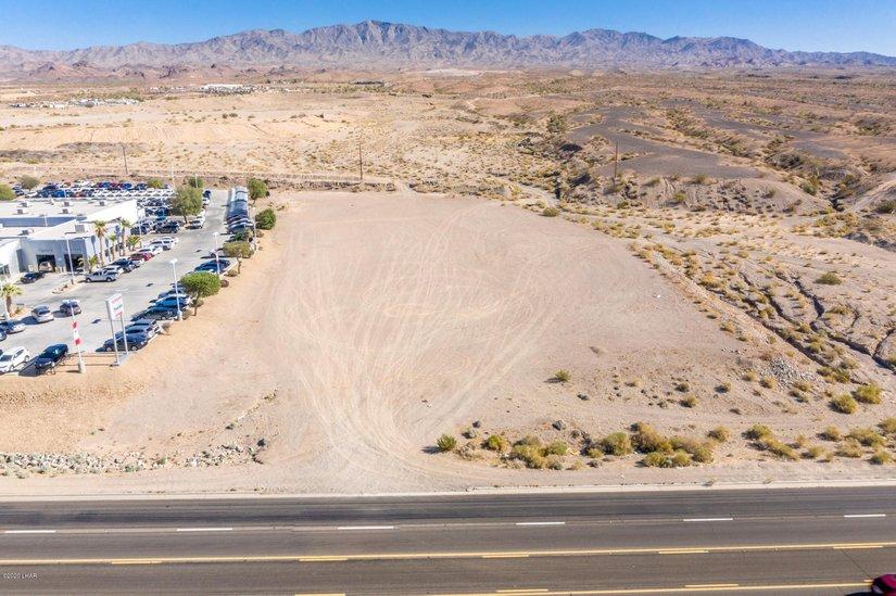 open plot of land beside road