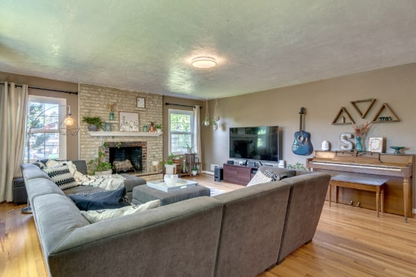spacious living room with rug, couch and coffee table