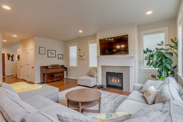 living room with fireplace and chairs