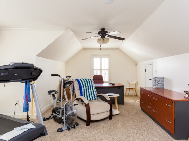 You have lots of options for this large room. 4th bedroom, office, media room, exercise room, game room, etc.. This room has two of the access doors to the walk out attic storage and a large closet. It is connected to bathroom also.
