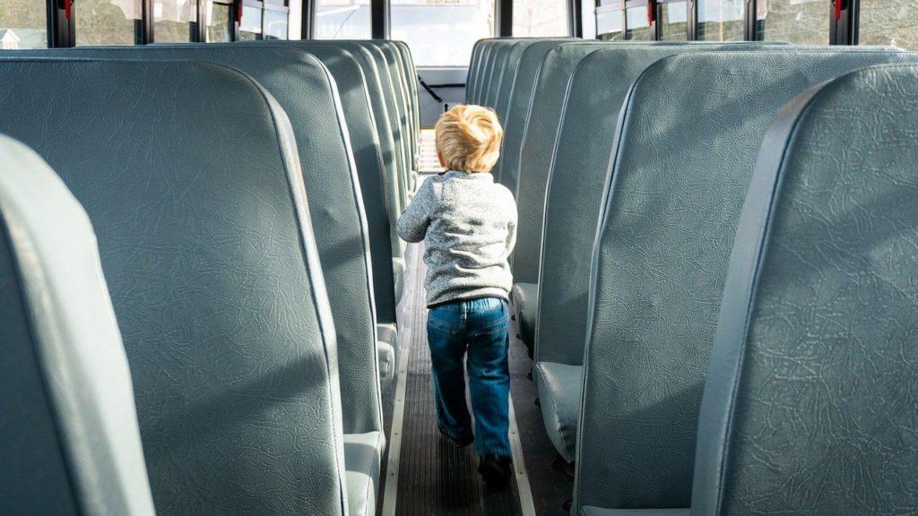 school bus, interior of school bus, school boy