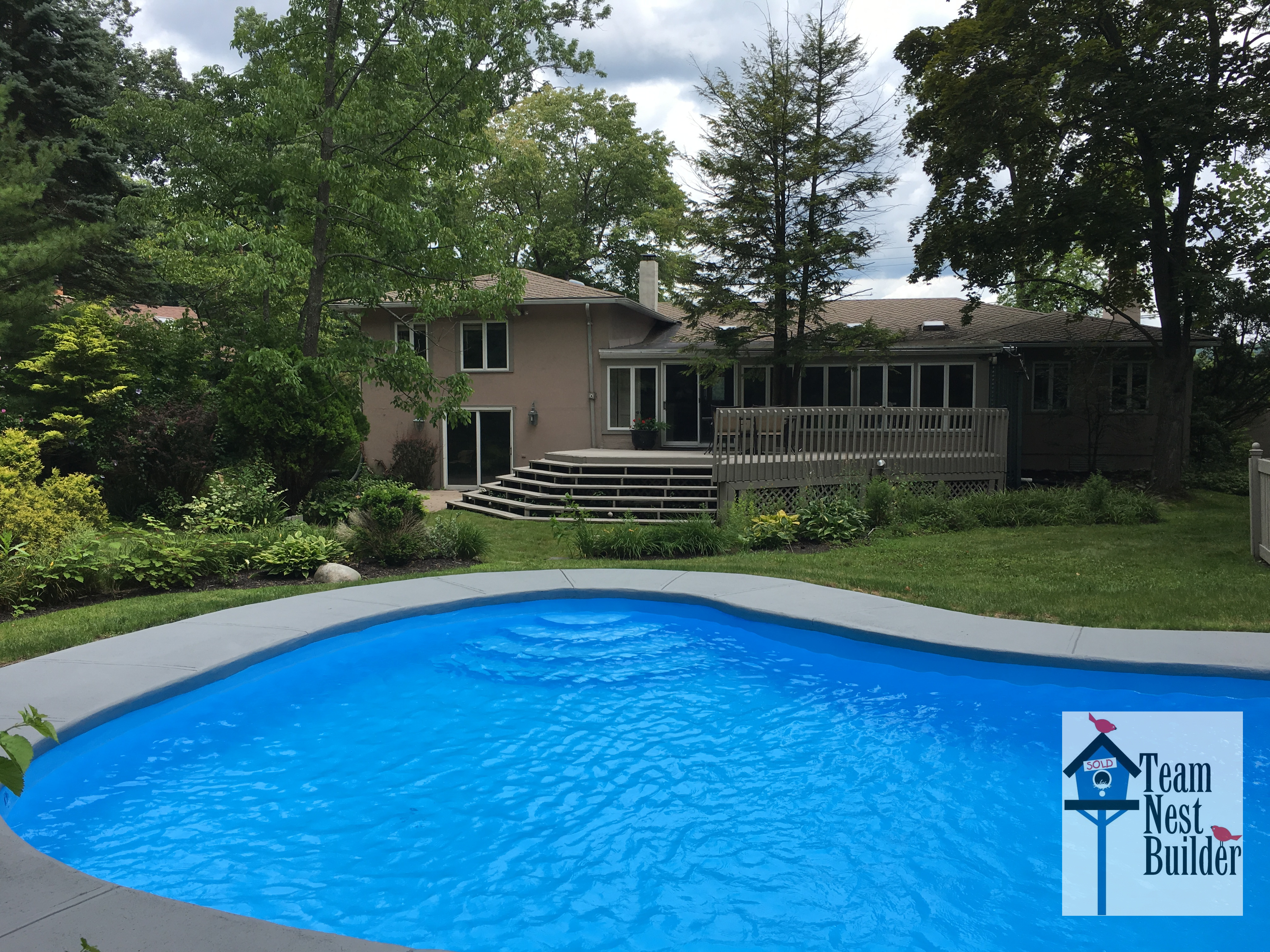 Check out the lovely landscaping and super-private heated in-ground pool!