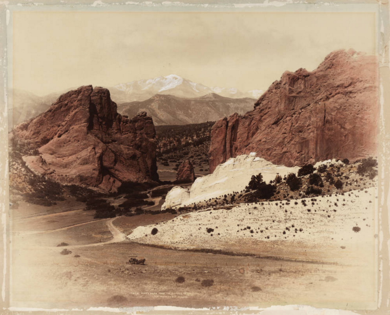 Imagsandstone rock formations and Gate Rock, a pillar at Garden of the Gods in Colorado Springs  Photo courtesy of  Western History and Genealogy Dept., Denver Public Library  William Henry Jackson Collection.e title
