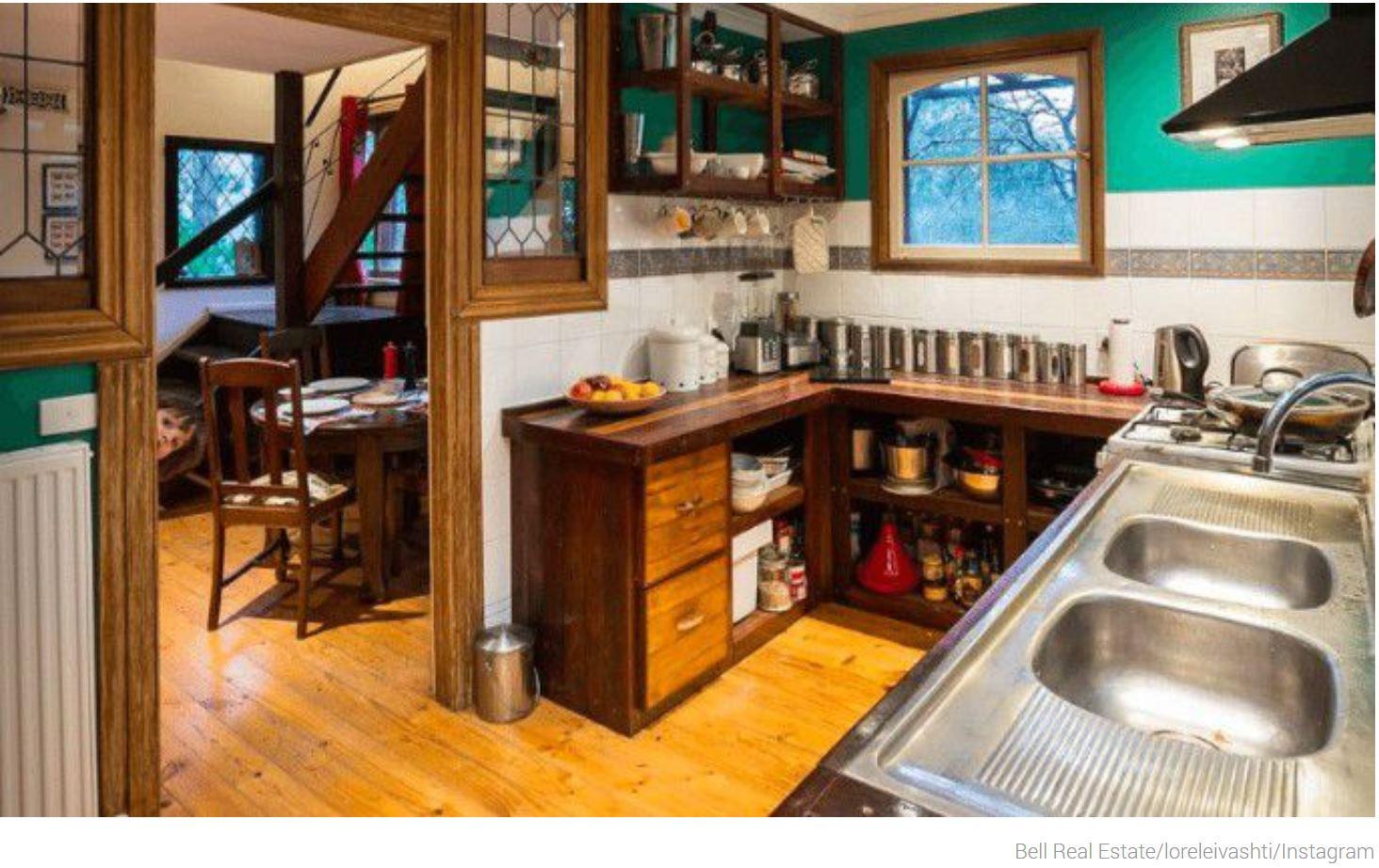 Kid Peeks Into Kitchen